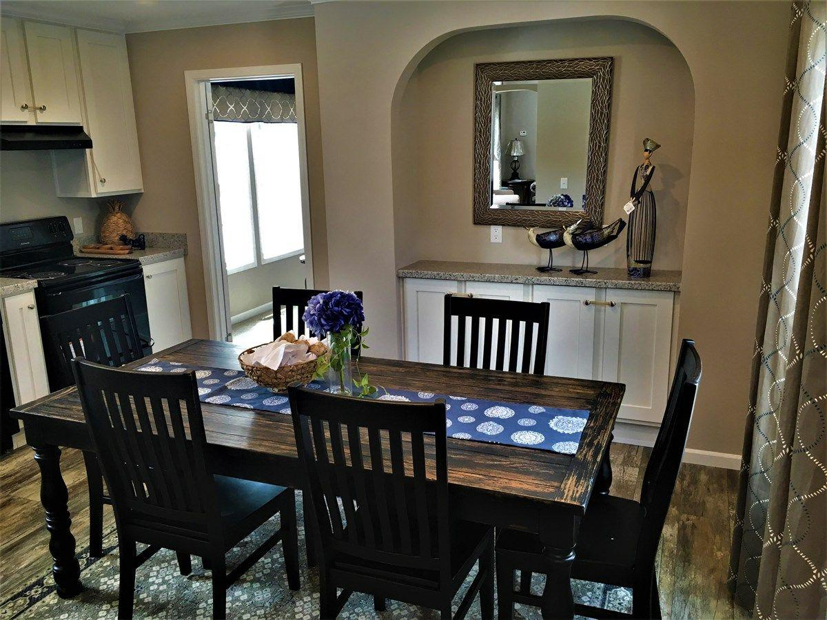 The Cozy Dining Area of the Sanders Cavalier Homes Manufactured Home from Magnolia Estates in Vicksburg, MS