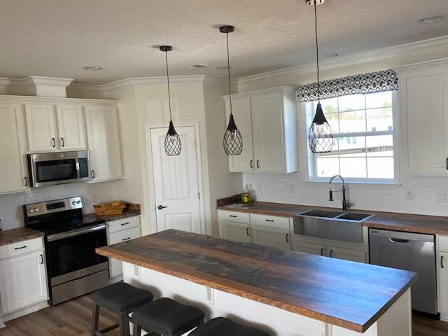 The Open Kitchen of the Grove Franklin Homes Manufactured Home from Magnolia Estates in Vicksburg, MS