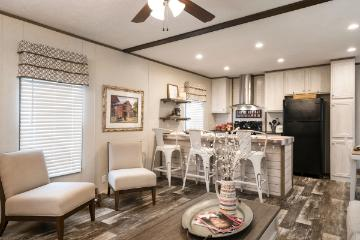 The Open Living Space of the EDG16642A a SE Southern Homes Manufactured Home from Moody Properties Demopolis in Demopolis, Alabama