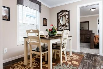 The Cozy Dining Area of the Averett Cavalier Home Builders Manufactured Home from Moody Properties Demopolis in Demopolis, Alabama