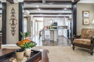 The Open Living Space of the McGarrity Cavalier Home Builders Manufactured Home from Worldwide Homes in Lumberton, Texas
