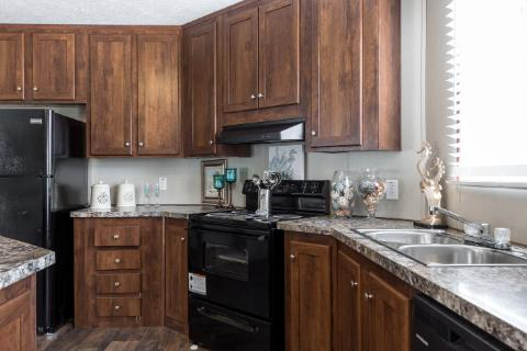 The Open Kitchen of the Hooper a Clayton Homes Manufactured Home from Worldwide Mobile Homes