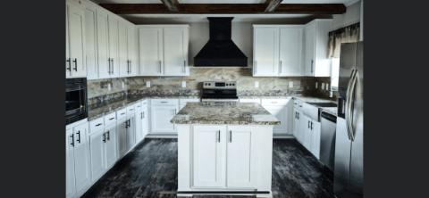 The Modern Kitchen of the Bryant Cavalier Home Builders Manufactured Home from Worldwide Homes in Lumberton, Texas
