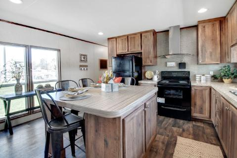 The Cozy Kitchen of the Rev 16 A Clayton Homes Manufactured Home from Worldwide Homes in Lumberton, Texas