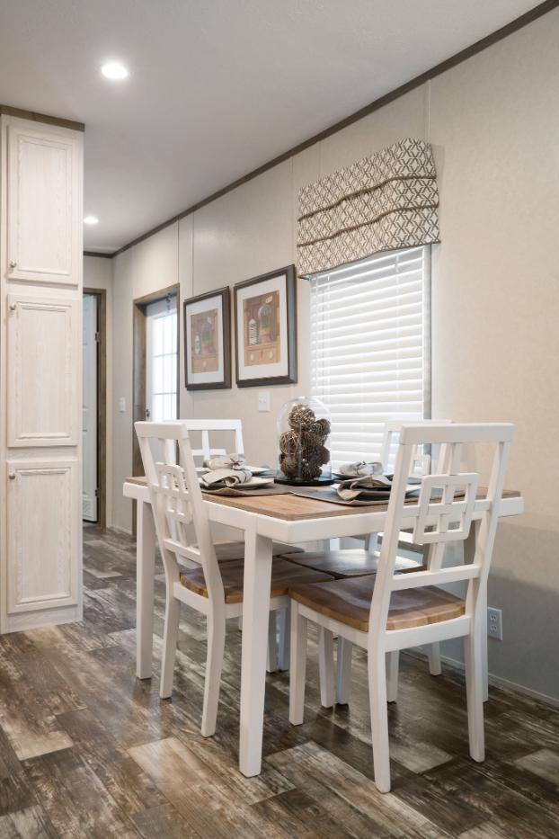 Dining Area in the Edge Manufactured Home from Worldwide Mobile Homes in Lumberton, Texas