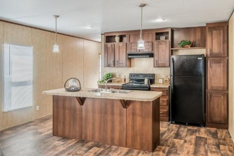 Kitchen of the Dragon Manufactured Home from Worldwide Mobile Homes in Lumberton, Texas