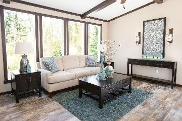 The Cozy Living Room of the Dewey Buccaneer Homes Manufactured Home from Worldwide Homes in Lumberton, Texas