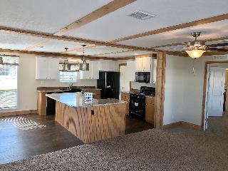 The Open Kitchen of the Legend Express 28x64 ScotBilt Homes Manufactured Home from Moody Properties Centreville in Centreville, AL