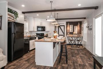 The Modern Kitchen of the Madison Hamilton Home Builders Manufactured Home from Moody Properties Centreville in Centreville, Alabama