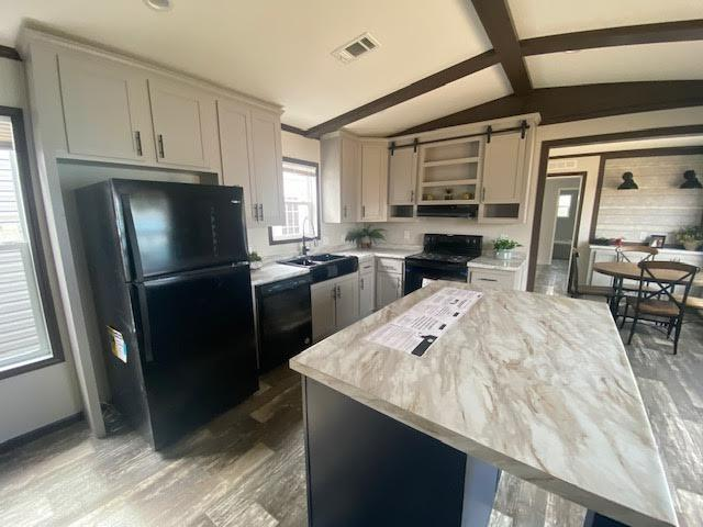 Kitchen of the Champion Premier by Champion located at Magnolia Estates in Brookhaven, MS
