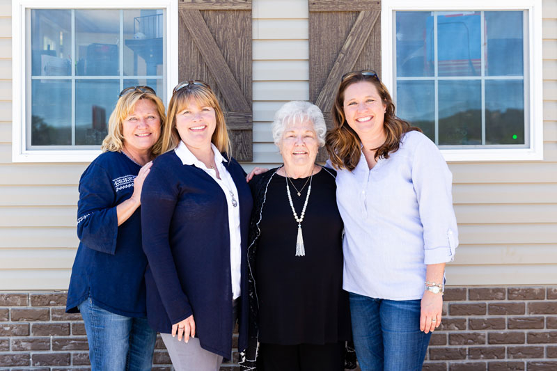 group of ladies in front of manufactured home