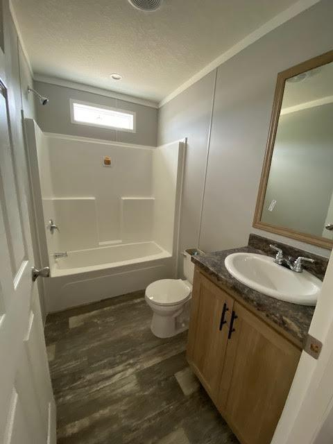 Bathroom with toilet and tub of the Champion manufactured of Magnolia Estates of pearl in Pearl, Mississippi