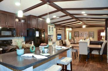 The Open Living Space of the Canyon Lake 32603G Fleetwood Homes Manufactured Home from Timberline Homes of Jasper, AL
