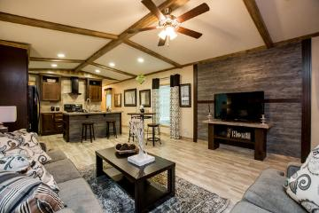 The Open Living Space of the Canyon Lake 16763K Fleetwood Homes Manufactured Home from Timberline Homes of Jasper, AL