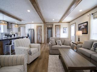 The Open Living Space of the Canyon Lake 32583H Fleetwood Homes Manufactured Home from Timberline Homes of Jasper, AL