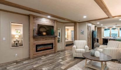 The Cozy Living Area of the Sandalwood 16763F Fleetwood Homes Manufactured Home from Timberline Homes of Jasper, AL