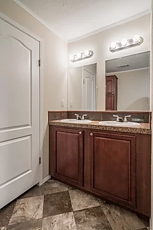 The bathroom of the Scot Bilt Legend manufactured home from Affordable Homes of Crestview