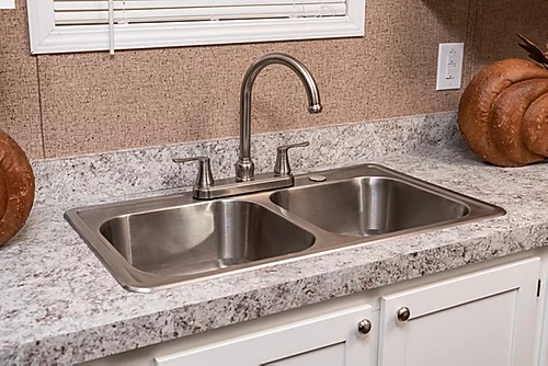The kitchen sink of the Scot Bilt Grand Slam manufactured home from Affordable Homes of Crestview