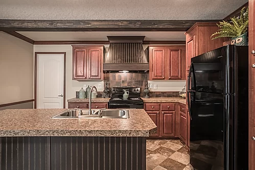 The kitchen of the Scot Bilt Legend manufactured home from Affordable Homes of Crestview