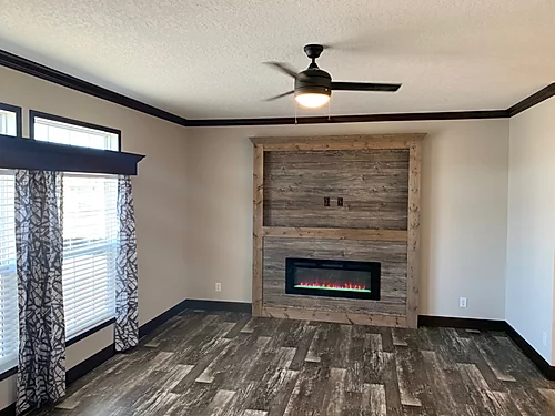 The fire place of the Scot Bilt Freedom manufactured home from Affordable Homes of Crestview