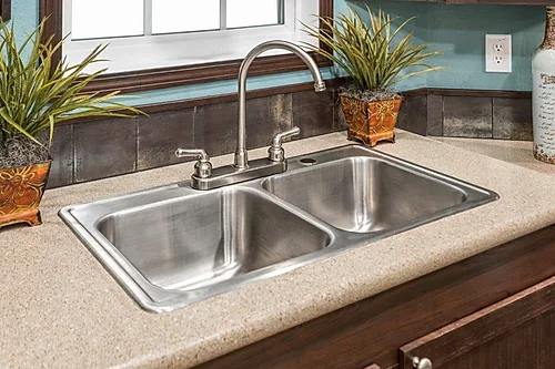 The kitchen sink of the Scot Bilt Legend manufactured home from Affordable Homes of Crestview