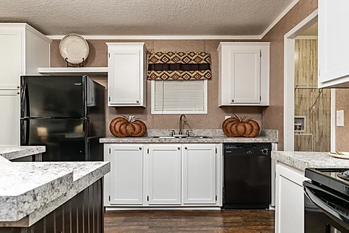 The kitchen of the Scot Bilt Grand Slam manufactured home from Affordable Homes of Crestview