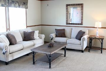The Cozy Living Space of the Nutcracker a Cavalier Homes Manufactured Home from Timberline Homes of Tuscaloosa, AL