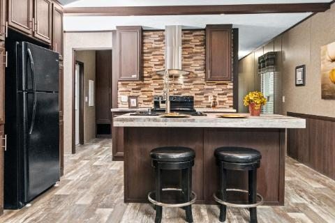 The Open Kitchen of the Parkside a Clayton Homes Manufactured Home from Timberline Homes of Lafayette, LA