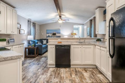 The Traditional Kitchen with Refrigerator of The Duncan a Cavalier Manufactured Home from Timberline Homes of Lafayette, LA