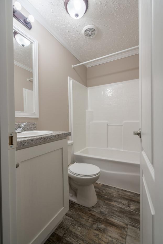 The Traditional Bathroom of The Duncan a Cavalier Manufactured Home