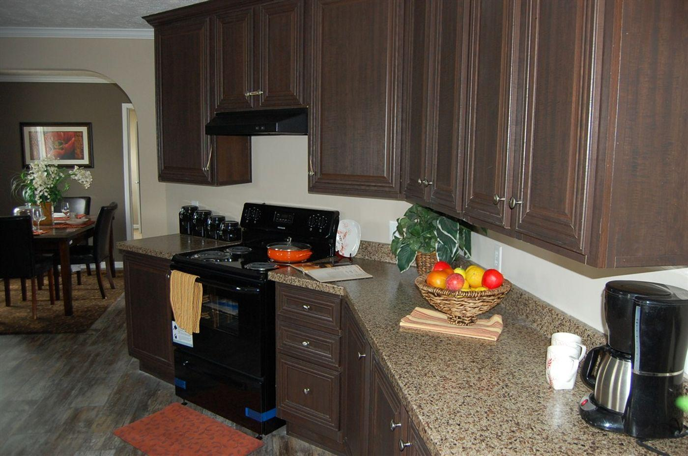 The Traditional Kitchen of The Duncan a Cavalier Manufactured Home